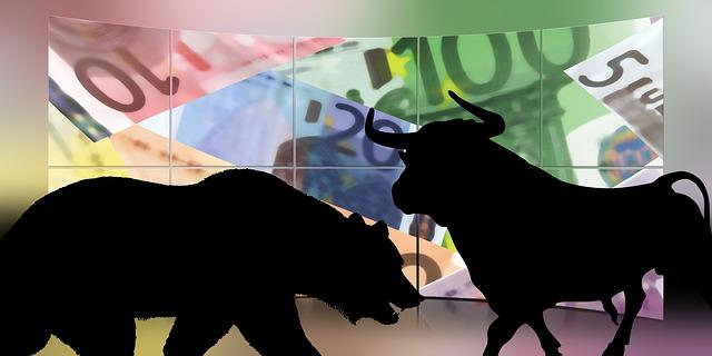 býk a medvěd – siluety, peníze, burza